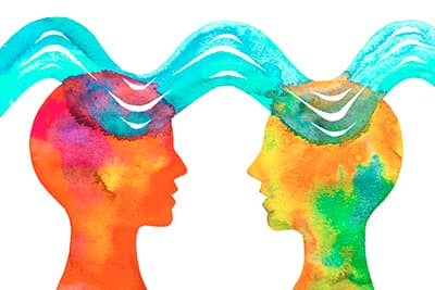 Watercolor image of two human heads with brain waves passing between them