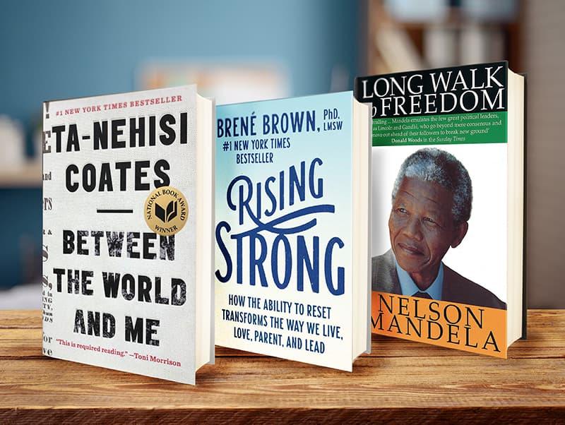 Photo of three books sitting on a shelf